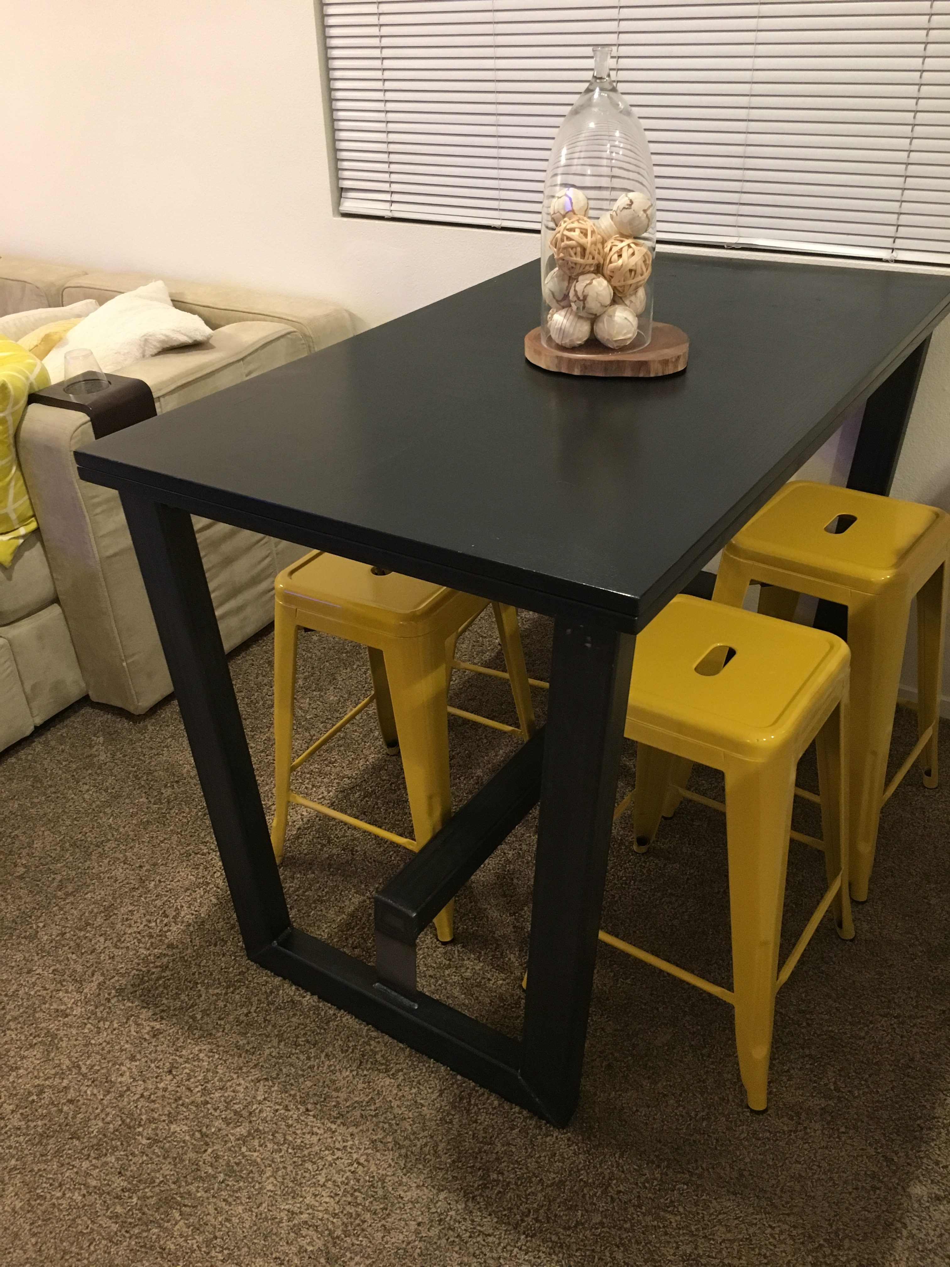 Folded table in its smaller form, on new bar height metal base with foot rest.